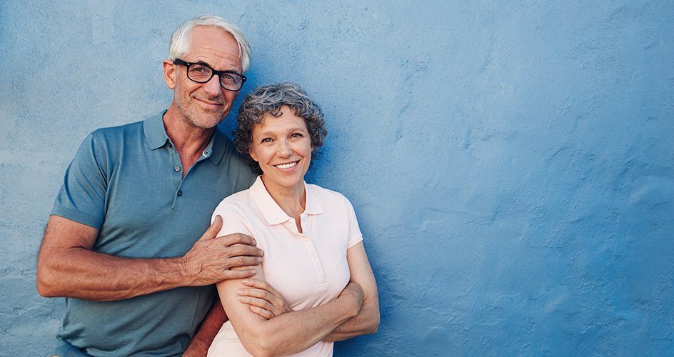 Man and woman leaning on blue wall